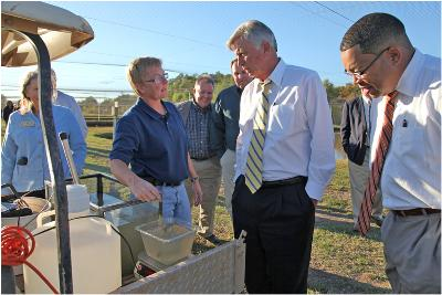Dr. Anita Kelly, Extension Aquaculture Specialist, talks with former Arkansas Governor Beebe and Lamar Davis.